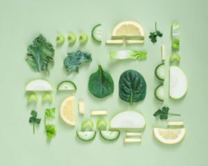 Photo of artfully arranged green fruits and vegetables