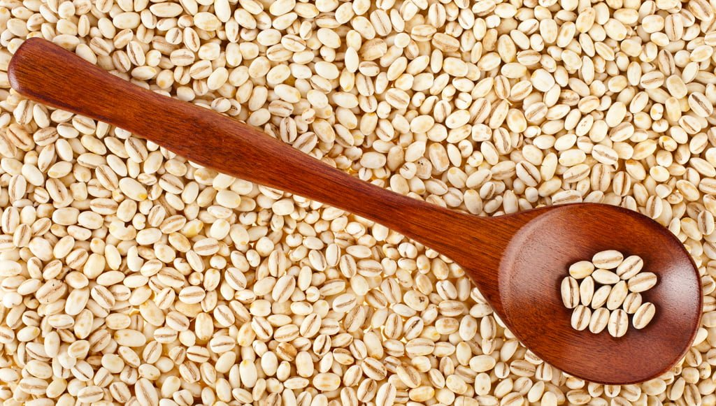 connection acne gluten wooden spoon on barley