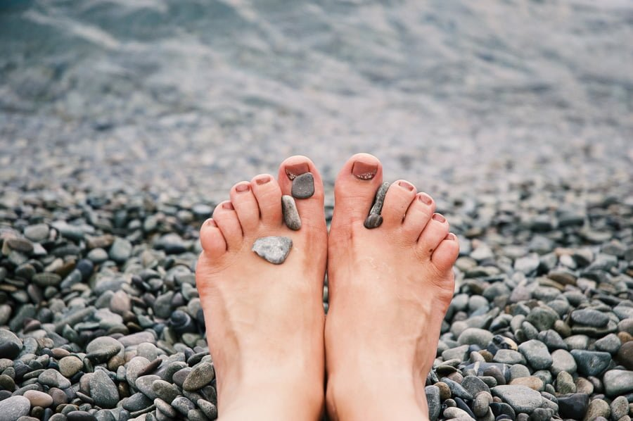 stones-on-woman-s-feet
